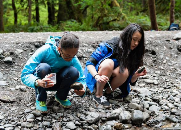 Students practice science at a gravel bar