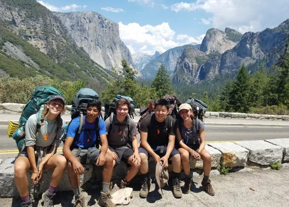 Backpackers sitting together in Yosemite Valley
