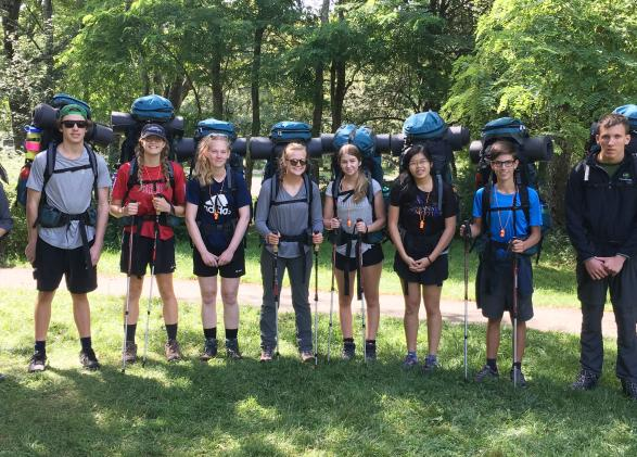 The Alcoa Scholars posing with their backpacking equipment.