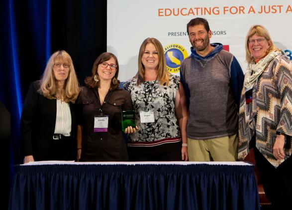 AEOE members receiving award, photo courtesy of NAAEE conference photographer Melissa Blackwell.