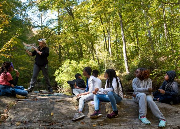 A NatureBridg educator teachers her students in Prince William Forest