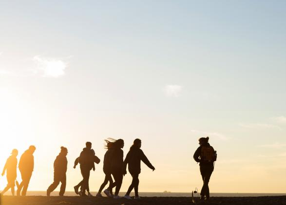 TEEM participants walk across Rodeo Beach at sunset. Photo by Daniel Sharpe.