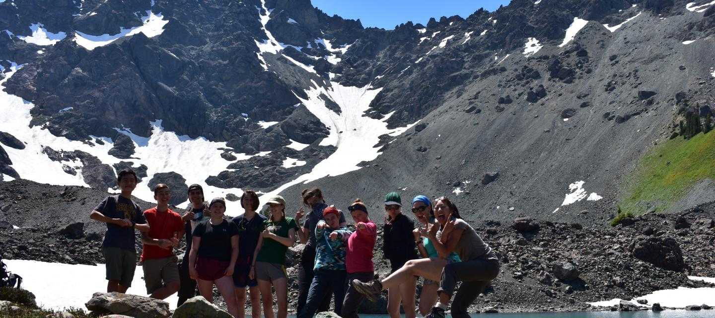 Students smiling in front of Royal Lake, Olympic National Park