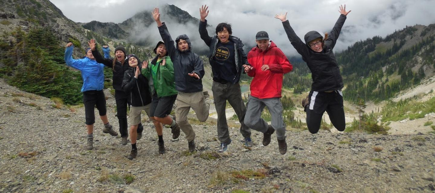 Student jump at the top of Gray Wolf Pass