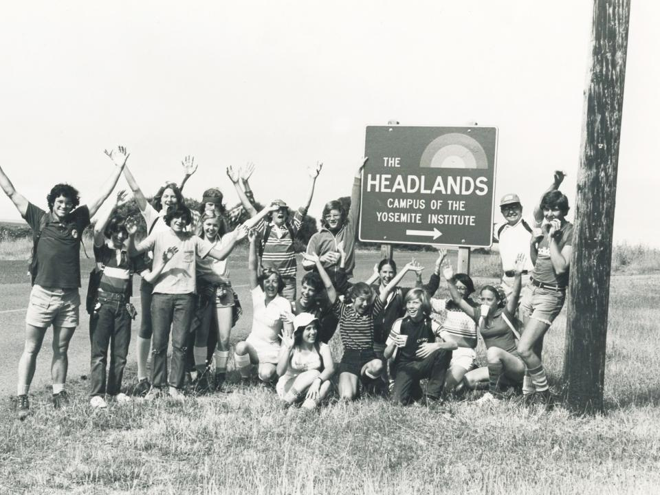 NatureBridge students and staff pose next to the Headlands Institute sign in 1977.