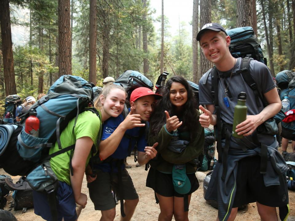 Students celebrate completing their backpacking trip