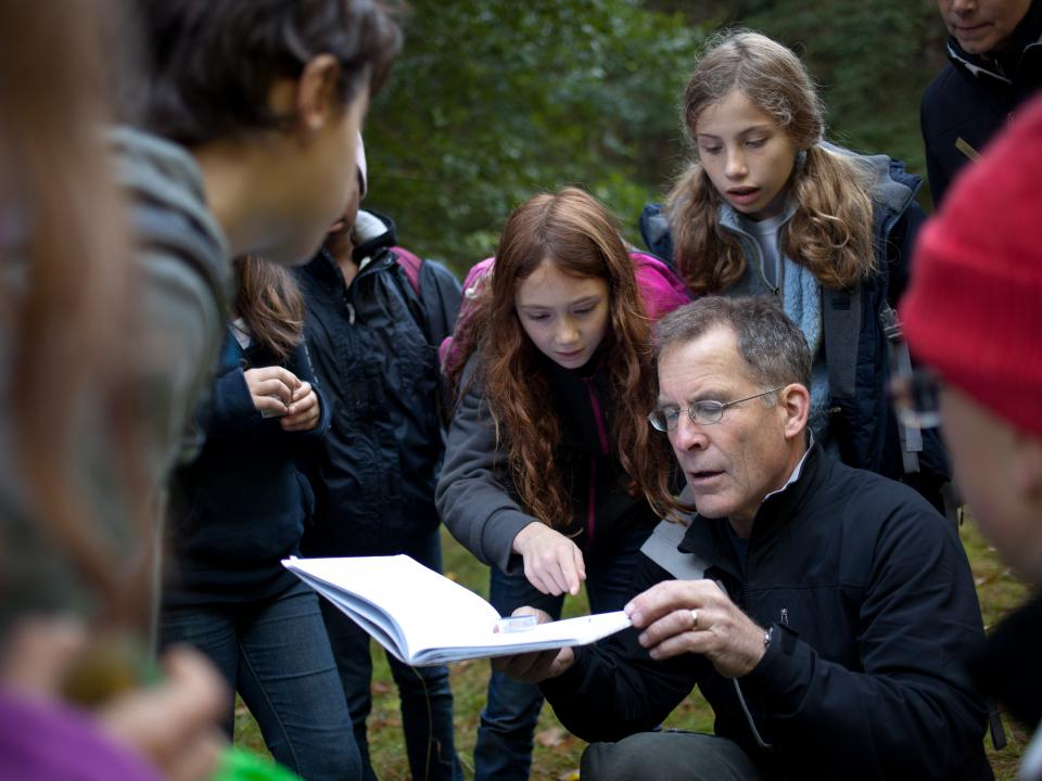 NatureBridge educator guides students as they investigate the natural world