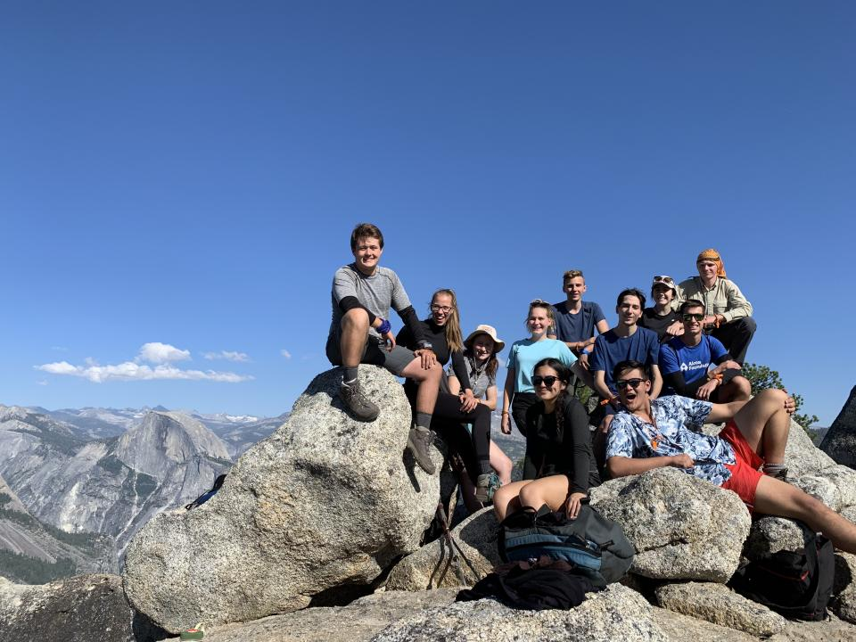 Group photo of Yosemite Alcoa Scholars with Half Dome in background