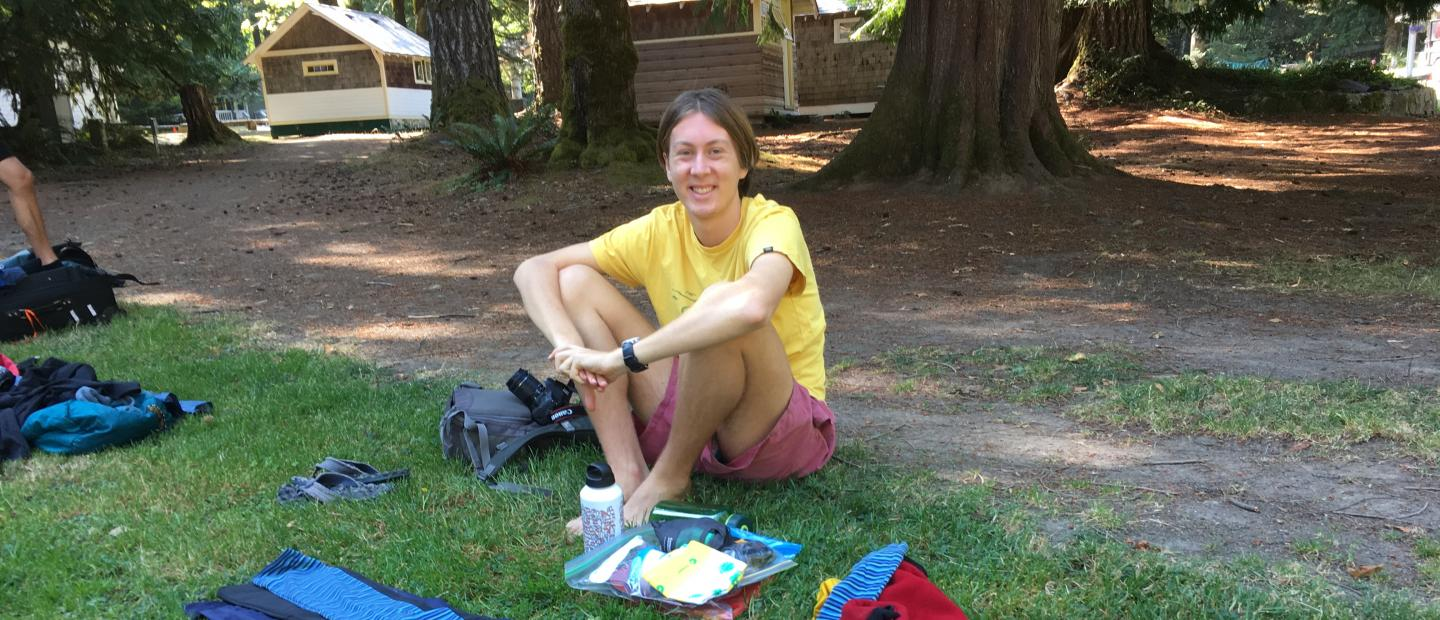 A Scholar arranges gear for the upcoming backpacking trip.