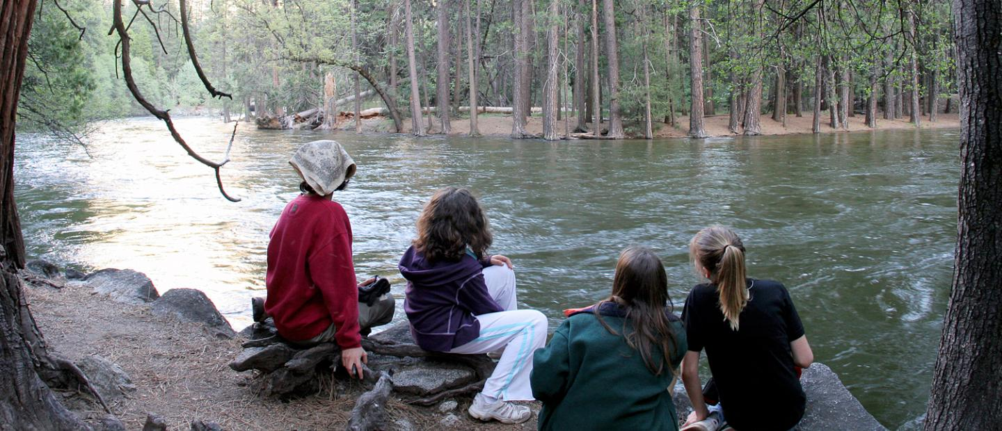Joni and her classmates on the shore of the Merced River.