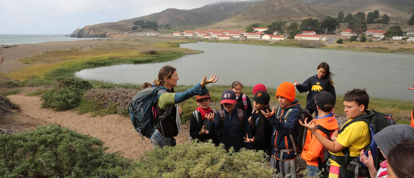 students on trail overlooking Rodeo Lagoon